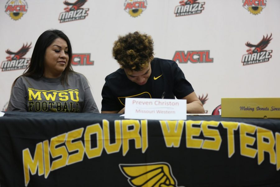 Senior Preven Christon signs to Missouri Western State University for football.
