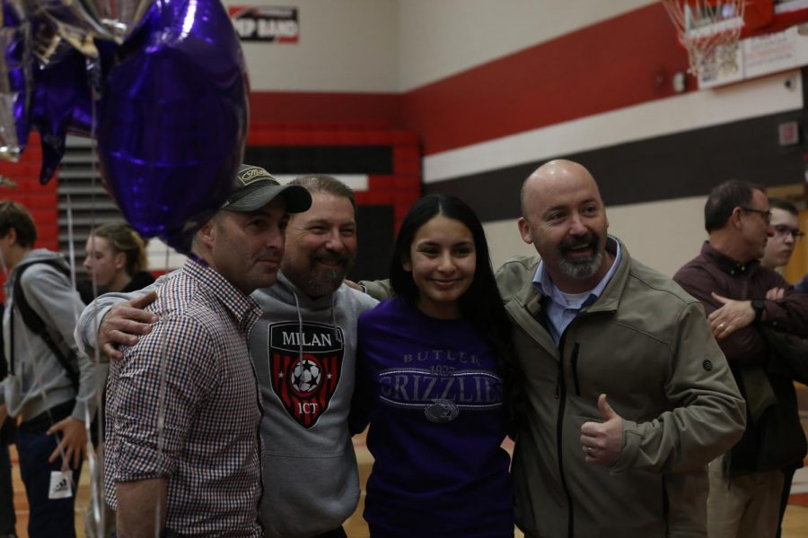 Senior Nayeli Reveles with her high school and club soccer coaches after her signing to Butler Community College.