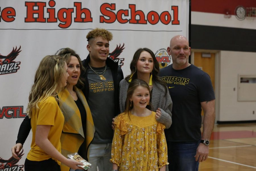 Senior Andrew Hanlin and family posing for a picture after Hanlin's signing.