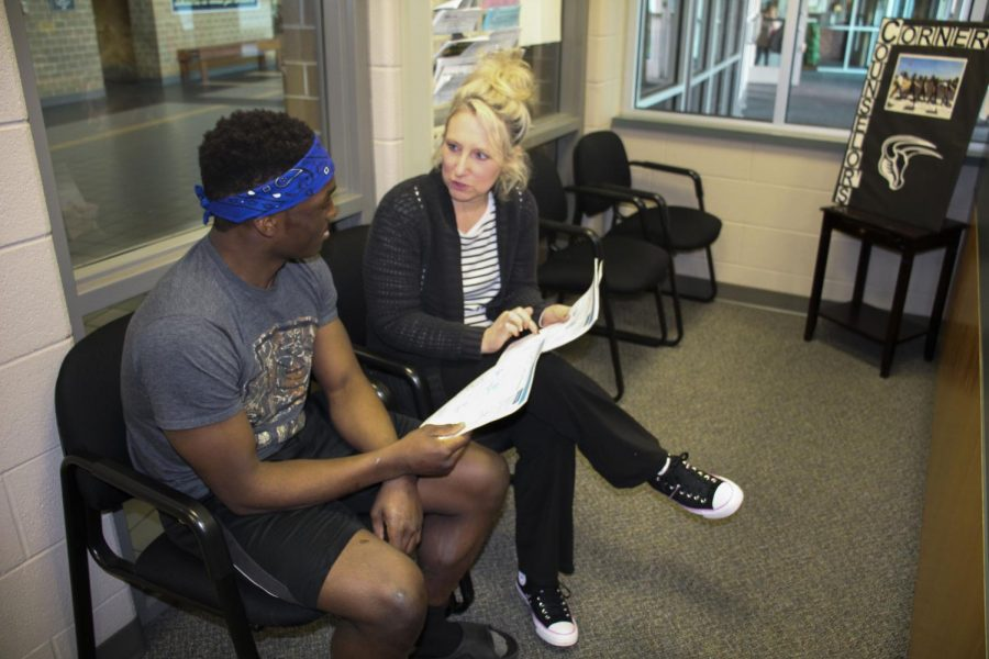 Counselor Tamara Luce explains a college parchment account to senior Lynauz Cox to inform him of college opportunities after graduation.
