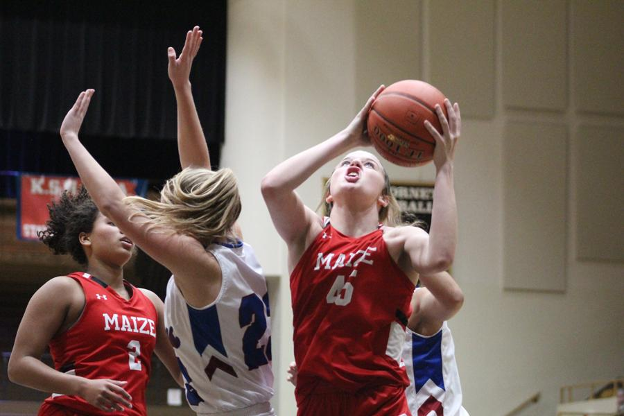 Olivia Wedman goes up for a layup in the second half. Wedman scored a total of four points in the game.