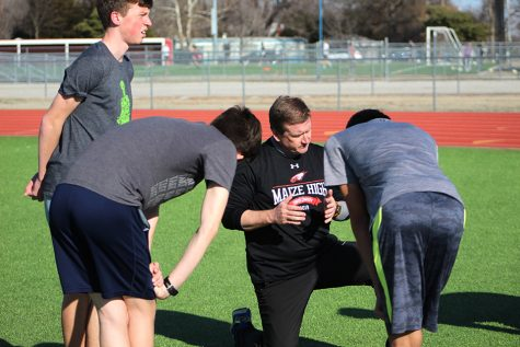 Track coach Skeeter Rankins talks with some of his athletes during a practice March 1. As of March 13, all practices at Maize have been suspended due to concerns over Coronavirus.