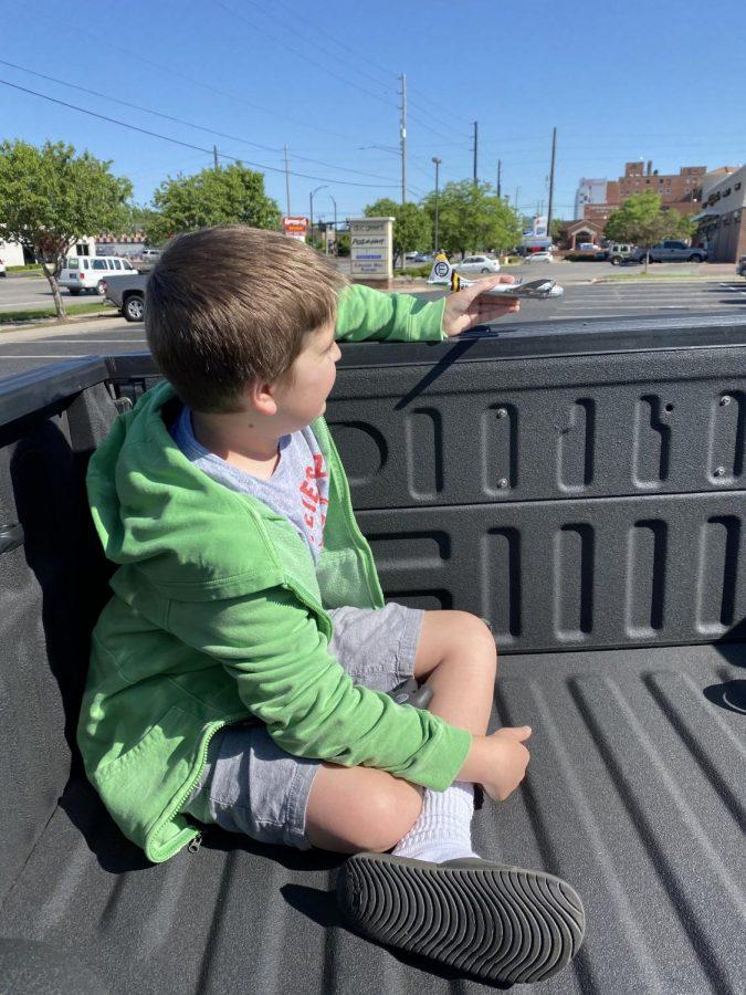 Jackson Jurden, Maize South Elementary student, plays with his Doc B-29 toy his mother bought for him at the reveal of the bomber Superfortress over west Wichita.