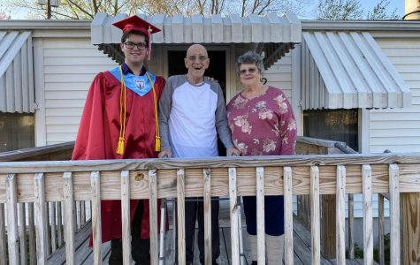 Senior Casey Loving visited his grandparents in New Jersey earlier this month. He was happy that he got to take a photo in his graduation gown with his grandfather who died Monday.