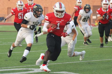 Senior Joshua Sanders runs the ball towards the end zone for a touchdown. Sanders scored the first touchdown of the game in the first quarter.