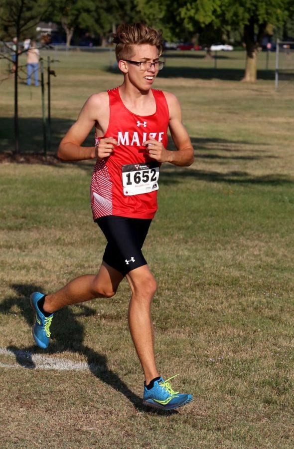 Senior Trey Davis continues to push towards the finish line. Davis placed fourth with a time of 20:46.
