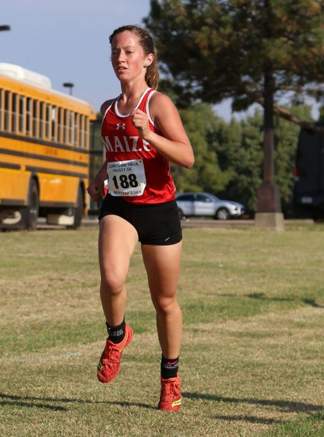 Sophomore Abigail Grantham paces herself during the start of the race. Grantham set her Kansas personal record at 21:49.