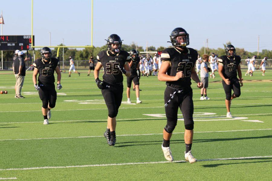 Maize South players warm up for their first home game against Great Bend on Friday, Sept. 4. The Mavericks would outscore the Panthers 56-0  in their first win of the year.