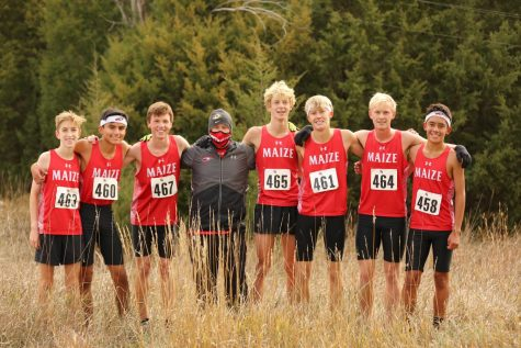 The boys cross country varsity team takes a photo after their win at Regionals. The team will now prepare for the state meet Oct 31.