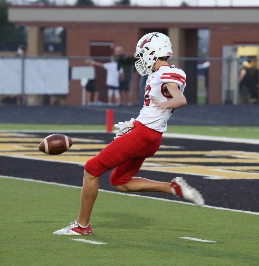 Junior wide receiver Kyle Grill punts the ball. Grill has been playing throughout high school.