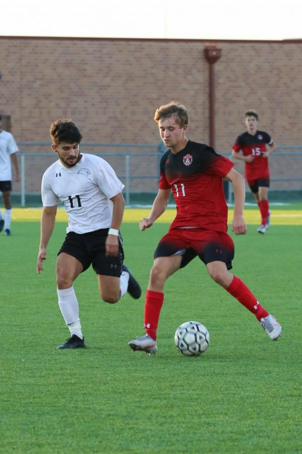Senior Max Shae runs past his opponent in the first half of the game. Maize defeated Campus 3-1 in this game.