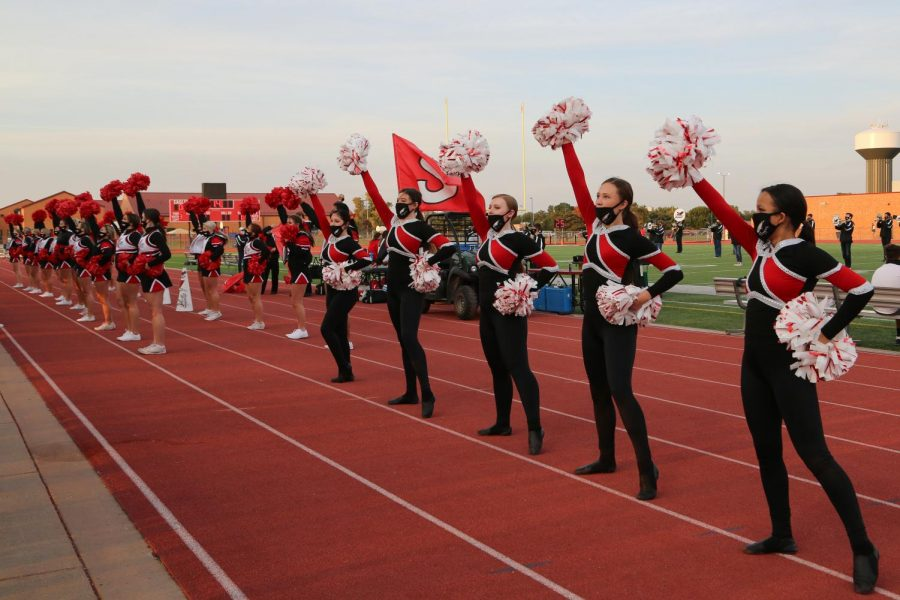 Cheer and Flygirls get the crowd excited before kickoff against Salina South.