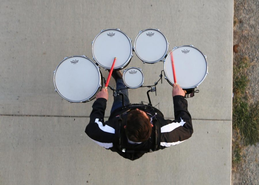 Announcing the football team, the drumline comes out from under the bleachers to set the fourth game in motion.