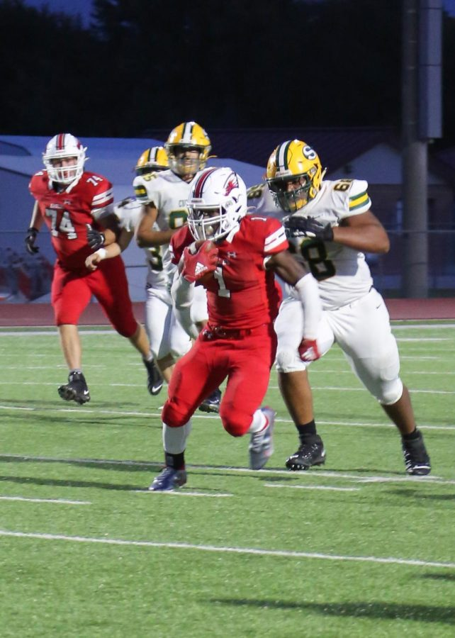 Senior running back Joshua Sanders goes for the endzone in the first quarter. Sanders scored the first touchdown of the game.