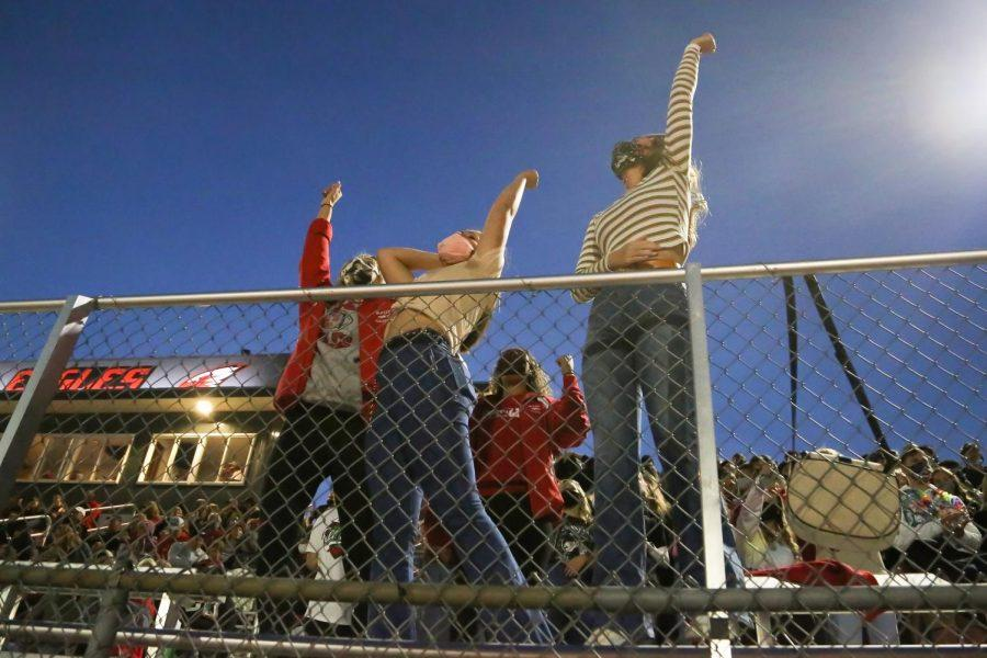 Seniors Mallorie Koehn, Makenzie Elsea and Abigail Hanlin cheer in The Nest after scoring a touchdown before halftime.