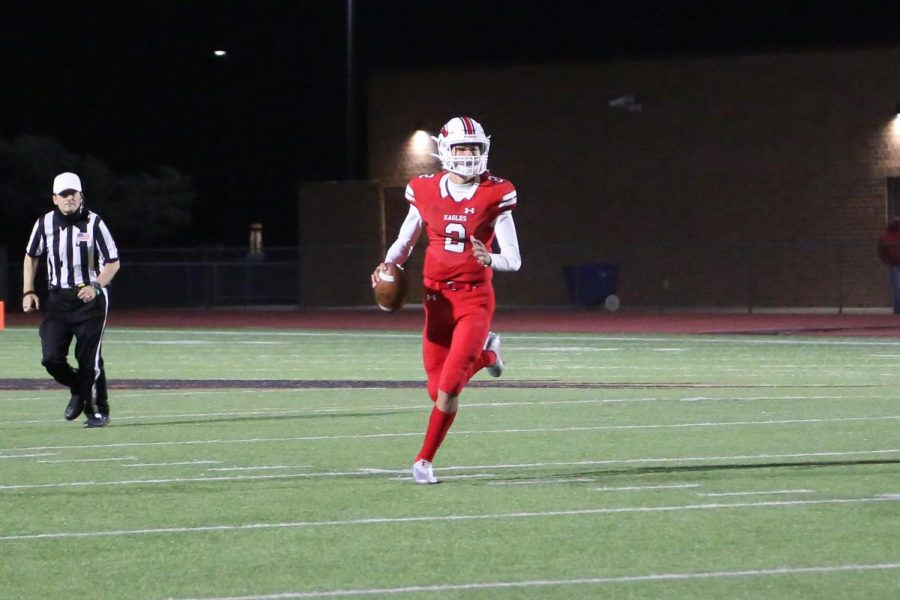 Sophomore quarterback Avery Johnson runs with the ball in the second quarter. Johnson scored a touchdown, making the score 49-13.