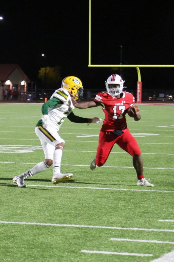 Sophomore running back Tayveon Williams blocks an opponent from Salina South at the 25 yard line.