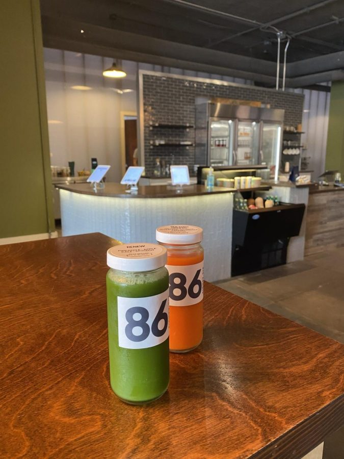 86 Cold Press stores their freshly made juices in a large refridgerator at the register to keep the drinks cool and ready to pick up and go about your day.