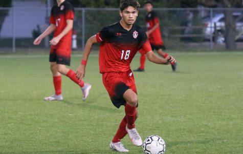 Senior Mikey Valesquez looks for a pass during the first half. Maize beat Newton with a final score of 1-0.