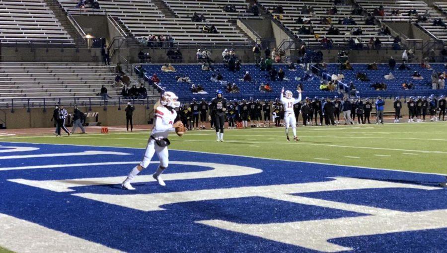 Sophomore quarter back Avery Johnson scores a touchdown.