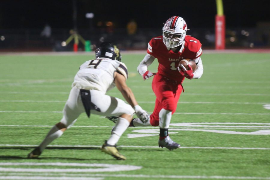 Senior Josh Sanders rushes the ball towards the end zone. Sanders scored four touchdowns in the game.