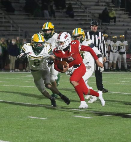 Sophomore quarterback Avery Johnson drives the ball down the field in an attempt to score. Johnson had one touchdown against Bishop Carroll.