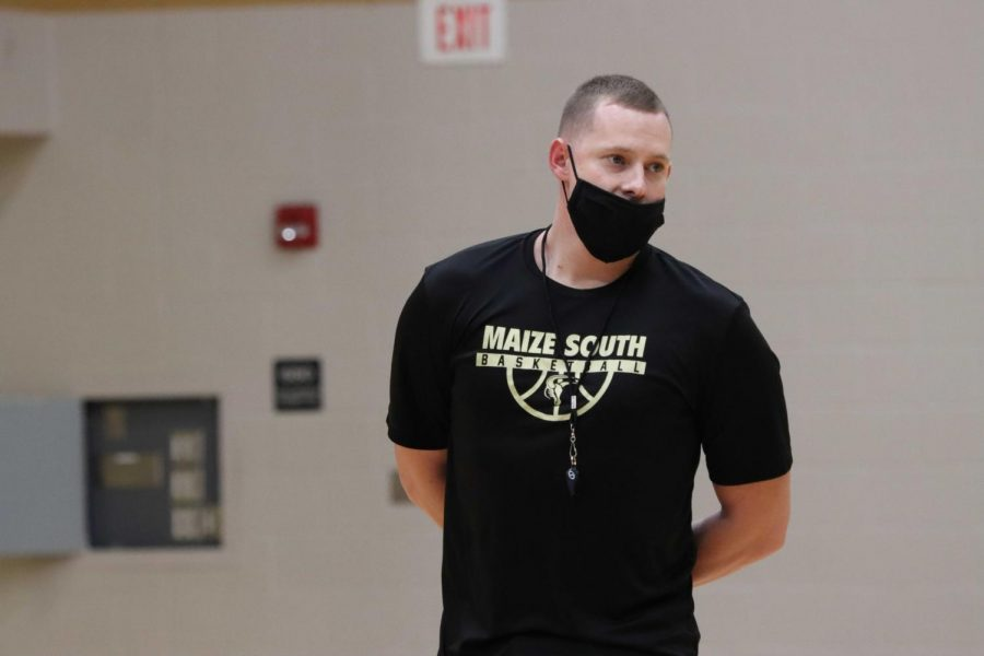 New assistant coach Zach Bush coaches and directs players during try-out week on Wednesday, Nov. 18. With Maize South moving to Division 1 in the AVCTL league, Bush won't get the chance to play his hometown school, the Eisenhower Tigers his first year.