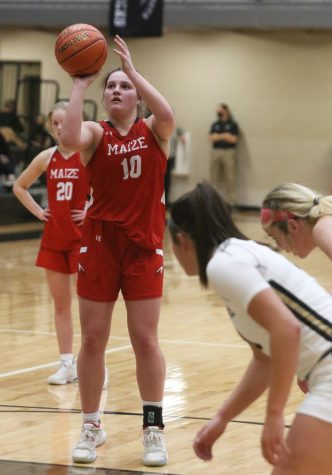 Senior Sydney Holmes shoots a free throw after being fouled in the fourth quarter. The Lady Eagles won with a final score of 51-31 against Maize South.