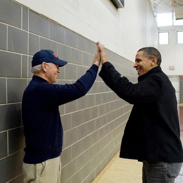 President elect Joe Biden high fives President Obama in 2015.