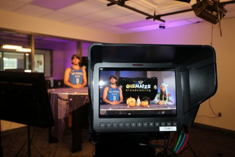 Senior Dakota Crane anchors for The OneMa1ze Broadcasting team for the 2020 Halloween episode. The OneMa1ze Show earned an All-Kansas award with Crane as a lead anchor for the show last school year.