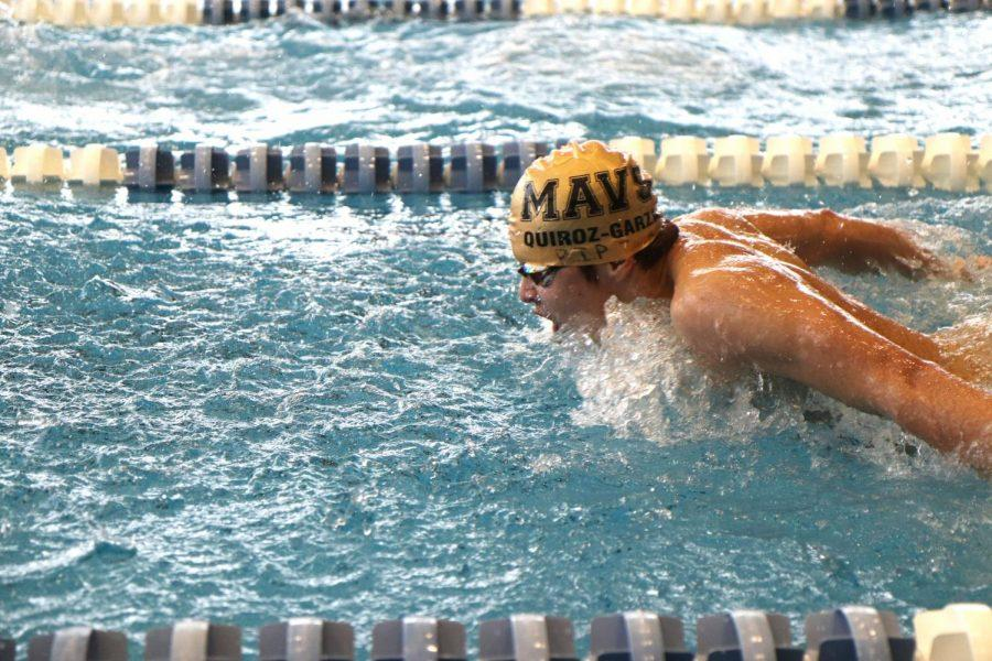 Fabrizio Quiroz (11), swims his freestyle race while competing in the  butterfly stroke.  Quiroz finished 8th in the 500 freestyle on the day.