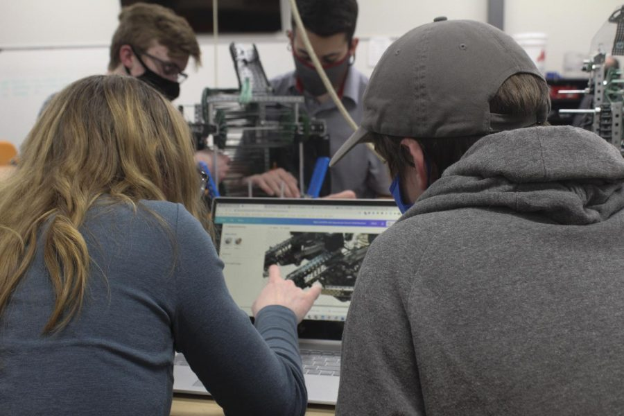 Juniors Brylea Schmidt and Ben Gorman focus on a CAD model for their robot to help with the design of their robot that they built. The team recently competed in Hesston this past Saturday and Hesston usually serves as the site for state robotics each spring.