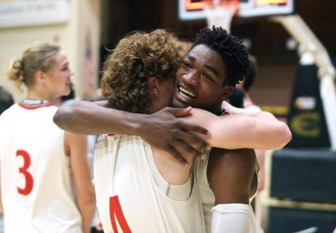 Senior Jacob Hanna hugs sophomore Justin Stephens after winning the first state basketball championship in Maize