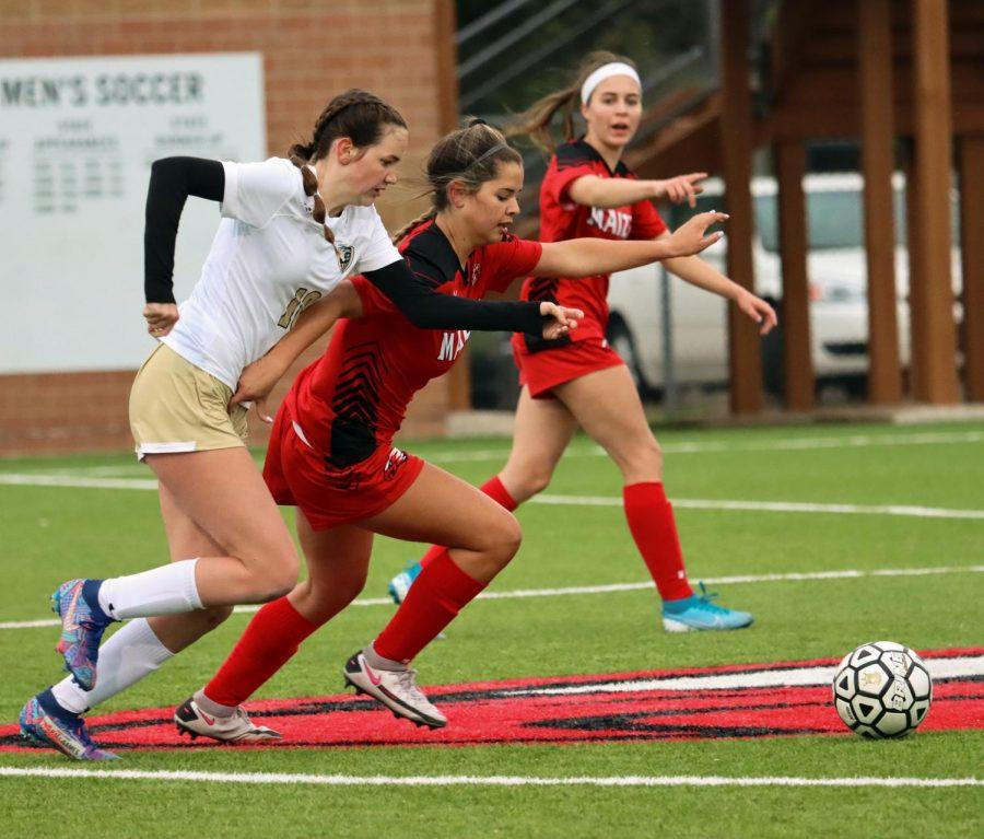 After Maize High scored a goal, Kyndal Ewertz (09) fights her way to pass through the opposing team's defense so that she could pass it to one of her teammates. Addison Hendershot made two saves as goalkeeper for the game.