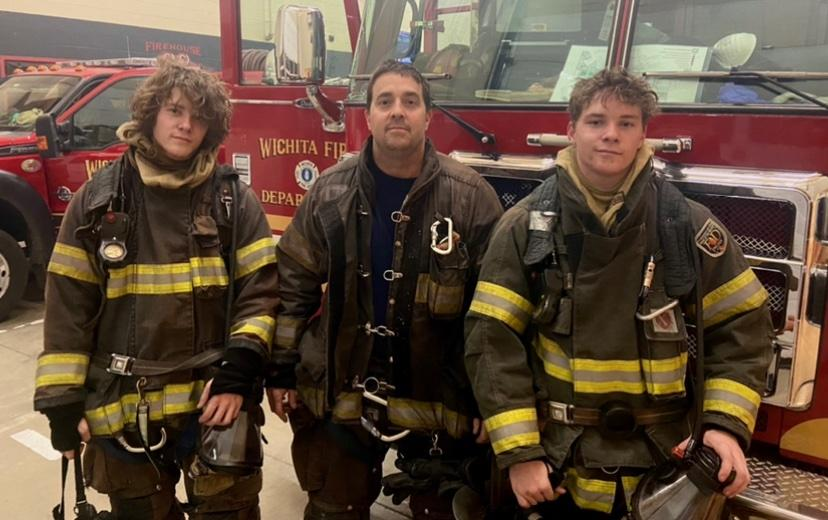 From left to right, Hunter Niemann, Keith Niemann, and Braden Niemann for a photo while in their firefighting gear. When I was promoted to LT they came up as toddlers, they were playing on the hosebed of my engine when a first due house fire came out so we had to quickly heard them off the hosebed so we could get to the fire, Keith Niemann said. Now that they are older they can come ride out and take part in training, it's cool sharing the fun aspects of the job with them.