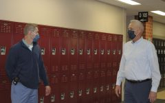 David Hickerson and David Nash discuss the upcoming changes in the school district in the Maize South hallway during EnCor. Hickerson established MavTime to give students an additional relaxed period during their day, which has been reverted back into EnCor to fit the COVID-19 precautions. Teri Larson, an English teacher at Maize South, said