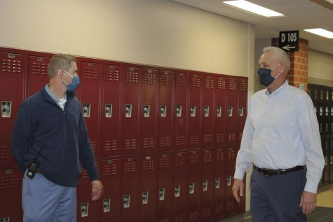"""David Hickerson and David Nash discuss the upcoming changes in the school district in the Maize South hallway during EnCor. Hickerson established MavTime to give students an additional relaxed period during their day, which has been reverted back into EnCor to fit the COVID-19 precautions. Teri Larson, an English teacher at Maize South, said """"Students loved it. Unfortunately, due to COVID, MavTime had to be changed back to EnCor because of social distancing."""""""
