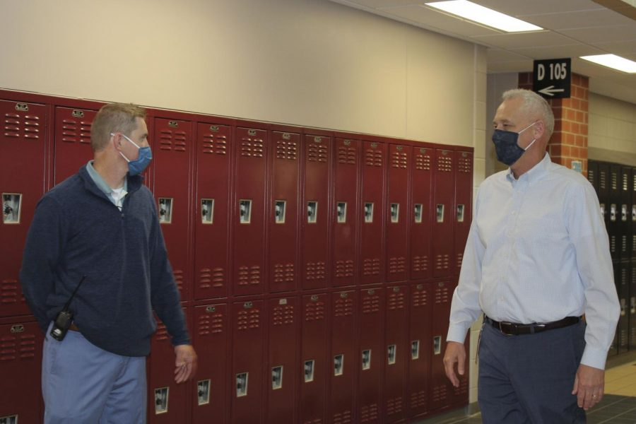 David Hickerson and David Nash discuss the upcoming changes in the school district in the Maize South hallway during EnCor. Hickerson established MavTime to give students an additional relaxed period during their day, which has been reverted back into EnCor to fit the COVID-19 precautions. Teri Larson, an English teacher at Maize South, said Students loved it. Unfortunately, due to COVID, MavTime had to be changed back to EnCor because of social distancing.
