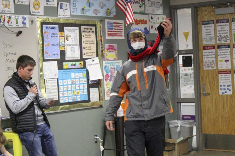 Blake (Juan) McCormick (11) shows off his bufanda (scarf), as Eric Berlin reads what he is wearing. McCormick bundled up for the class period in a winter coat and scarf as he acted as the season winter.