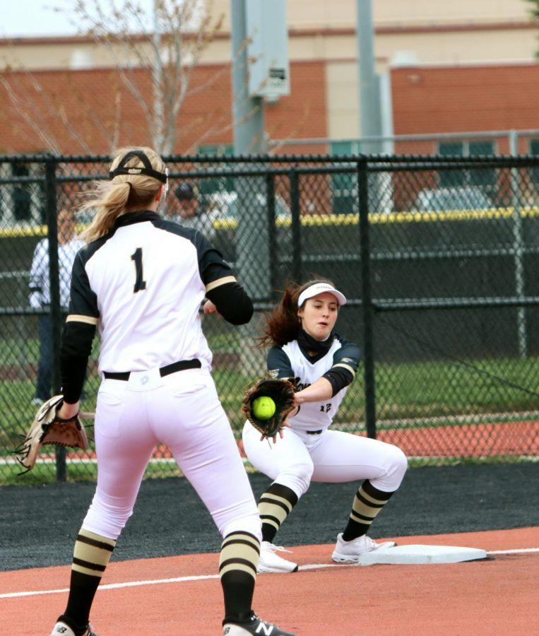 While a Andover player attempts to rush to the 3rd base, Holly Shafer, 11, quickly catches the ball from one of her teammates to punch out the Andover player. The girls continue their season this Friday in a doubleheader at Campus.
