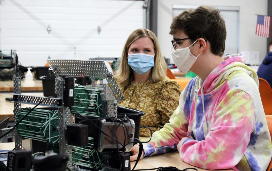 Robotics student Keaton Stwalley (10) shows Lindsay King his work during a 1st Block class as he codes a robot to run more autonomously on Monday, April 19. Robotics is just one of the hands on classes at the MCA that King strives to make more available for students of both Maize High and Maize South.