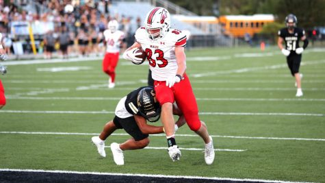 Aiden Doty scores on a 17-yard touchdown pass from Avery Johnson. Doty had six catches for 83 yards in the Eagles 54-10 victory over Newton.