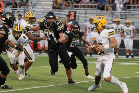 With Salina South breaking their play Senior Blake McComick rushes to the opponents quarterback to receive a tackle. McCormick had a total of five tackles and three assists on the defense.