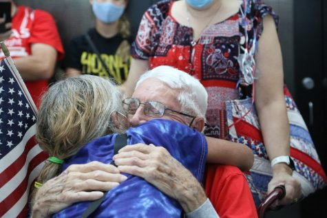 After being away from home for the trip, a veteran embraces a family member.