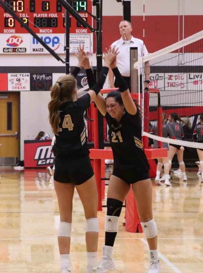 After scoring yet another point for the Mavs, junior Avery Lowe celebrates the score made with senior Skylar Lopez.