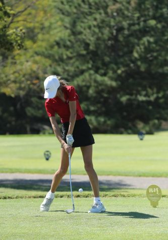 Freshman Charlotte Kerbs strikes  the ball at a recent tournament at Rolling Hills Country Club. She scored a 99 on the day, helping Maize High place fourth at the tournament.