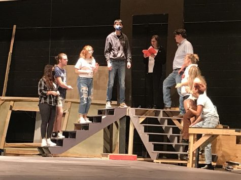 Rehearsing the second half of show while practicing blocking in the MHS auditorium, Katelyn Coffey (09), Caden Cauthon (12), Marrisa Dowell (12), Dashall Meyer (10), Alexis Winegarner (12), Warren Swedberg (12), Jaden Murdock (10), Kinsley Morrison (11), Liliana Cabrera (12) work on how the cast will leave the set for a scene on Monday, Oct. 11.