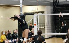 Sophomore Gracie Morrow aggressively goes up  to swing against Campus. The Maize South squad ended up winning that game 2-0 at home on senior night. The Lady Mavericks are 16-3 on the road this season.